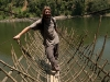 Me on a local style suspension bridge, Kabu, near Along.