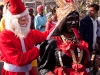 Santa Claus among the other Hindu gods at the celebration of Pos Sud Purnima at Ambaji.
