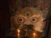 Guardian figure with butter lamps, Tikse Monastery.