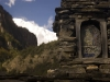 Buddhist icon on a mani stone wall near Ghyanu Annapurna circuit trek.