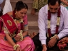 The groom\'s parents performing a puja on the 2nd day of wedding events.