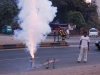 Shooting off very large fireworks in the middle of the street ahead of the wedding procession.
