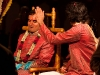 Vinay performs a less careful adjustment to the groom\'s hair.