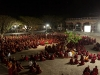 Monks gather to watch news report of Dalai Lama's meeting with President Obama
