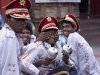 Band members prepare for a procession, Kailghat, Calcutta.