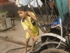 Child watching the procession from a rickshaw, Kailghat, Calcutta.