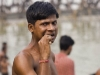 Man brushes his teeth by the Hooghly River, Calcutta.