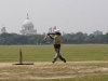 Playing cricket on the Maidan in front of the Victoria Memorial, Calcutta.