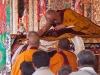 Receiving blessing from the Dalai Lama