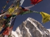 Prayer flags decorating the top of Kala Pattar (5600m/18,373 ft) with Pumori peak behind.