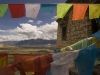 View through prayer flags from above Samye Monastery.