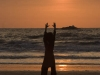 Girl doing some sort of yoga/ tai chi at sunset on Kudle beach, Gokarna.