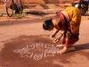 Drawing patterns on the street prior to the pulling of the Temple Cart, Shivaratri, Gokarna