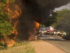 Firefighters losing the battle to put out the flames on an overturned petrol tanker, south of Hospet.