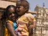 Happy girl with not so happy baby, Virupaksha Temple, Hampi.