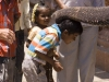 Boy gets blessed by temple elephant, Virupaksha Temple, Hampi.
