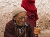 Ladakhi man with a prayer wheel, Hemis Festival.