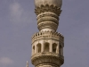 Minaret of a mosque on the grounds of the tombs of the Qutb Shani Kings, near Hyderabad.