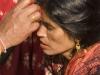 Woman receiving tika, Budhanikantha, Kathmandu Valley.