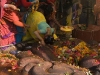 Woman worshipping at the feet of sleeping Vishnu, Budhanikantha, Kathmandu Valley.