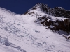 The steep snow slope leading beneath the Charang La