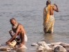 sadhu washing clothes, Kumbh Mela, Haridwar