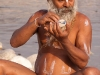Sadhu decorating his forehead, Kumbh Mela, Haridwar