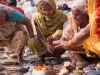 Woman worshiping, Kumbh Mela, Haridwar