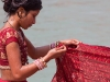 Woman drying her sari, Kumbh Mela, Haridwar