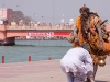 Man pays respect to passing Sadhu, Kumbh Mela, Haridwar