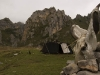 Yak skull and nomad tent with the jagged peaks of the gorge near Langmusi.