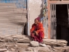 Monk sitting in the street, after the flash flood in Leh, August 6 2010