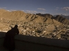 Monk looks out over Leh from the palace.