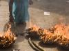 Burning offerings at Kumbeshwar Temple, Patan.