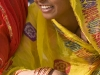 Smiling girl watching the closing ceremonies of Pushkar Camel Fair.