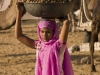 Woman carrying camel droppings, Pushkar.