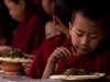 Young monks eating breakfast, Tawang Gompa
