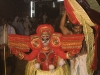Theyyam getting his headdress put on, Kannur District.