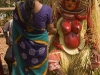 Woman receives consultation from Theyyam, Kannur District.