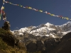Prayer flags and peaks on the way to Thorung La.