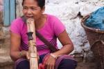 Woman smoking a bamboo pipe, Tlabug