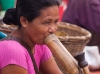 Woman smoking a bamboo pipe, Tlabug