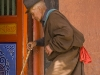 Pilgrim circumambulating Labrang monastery, Xiahe.
