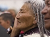Woman watching the  performance during the festival at Labrang monastery, Xiahe.