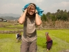 "Trying out the Apatani ""backpack,"" Ziro, photo by May."