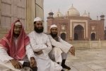 Muslim men in front of the mosque at the Taj Mahal, Agra.