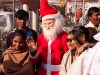 Pilgrims getting their picture taken with Santa Claus at the celebration of Pos Sud Purnima at Ambaji.