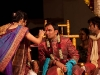 Women from the bride\'s family put a tikka on the groom.