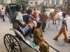 Watching the procession from a rickshaw, Kailghat, Calcutta.