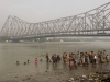 The truly devout bathing beneath the Howrah Bridge in the less than pristine yet holy waters of the Hooghly River, Calcutta.